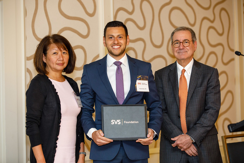 Ronald Fairman, MD, SVS Foundation Chair, presents an award to Karim Salem during SVS Foundation Update & Awards Ceremony