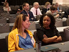 Attendees chat during the morning session