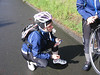 Helping a rider with a flat.