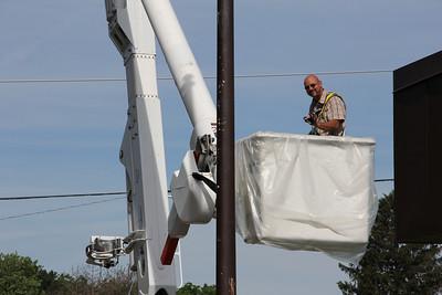 Jim Pauley bucket truck flag pole painting