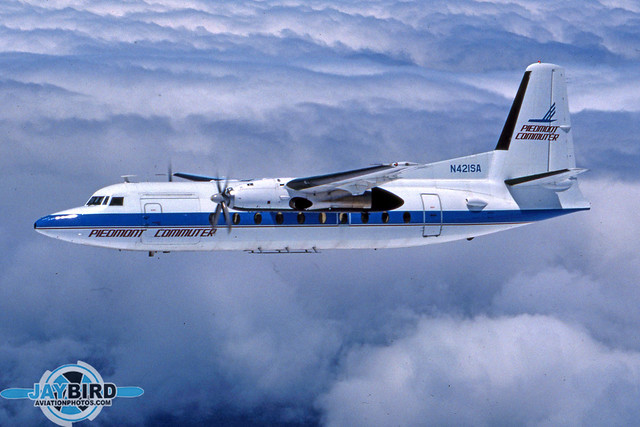 THIS IS PROBABLY MY FAVORITE VINTAGE AIR2AIR PHOTO. THE VERY LIGHT CLOUD LAYER ABOVE US DIFFUSED THE LIGHT SO THAT THIS LOOKS MORE LIKE A PAINTING THAN A PHOTO. N421SA WAS ORIGINALLY DELIVERED TO SWIFT AIR ON THE WEST COAST, AND WAS LATER SOLD TO AIR NORTH. WHEN IT WAS PAINTED IN PIEDMONT COMMUTER COLORS, THAT WAS MY CUE TO WRITE AN ARTICLE...AND, OH YEAH, TAKE A FEW PHOTOS AS WELL.