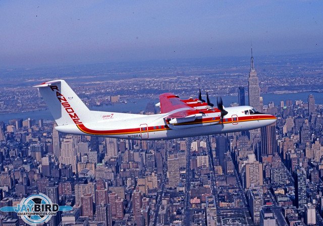"PROBABLY MY MOST ICONIC PHOTO SHOOT. RANSOME AIRLINES HAD DEPARTED FROM THE ALLEGHENY COMMUTER SYSTEM AND JUST RECEIVED A BRAND NEW  DASH 7 IN ITS OWN COLOR SCHEME. THE COMPANY ORGANIZED A PRESS PHOTO FLIGHT (WE WERE IN A NORD 262) AND WE MADE A COUPLE OF PASSES AROUND THE PHILADELPHIA AREA. AFTER THAT, THE DIRECTOR OF MARKETING ASKED IF ANYONE WANTED ANYTHING ELSE. I PIPED UP,  ""HOW ABOUT A SHOT IN FRONT OF THE EMPIRE STATE BUILDING?"" LIFE WAS SOOOOO0O SIMPLE 35 YEARS AGO..."