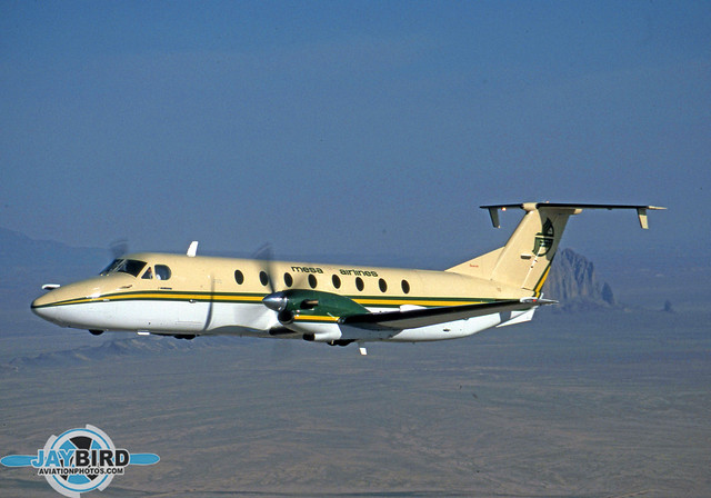 Back in the late 80s and very early 90s, Mesa Airlines operated a growing fleet of Beech 1900s. N91YV is shown in  the carrier's original color scheme with Shiprock in the background.