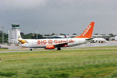 EasyJet B737-300 G-EZJD. Big @ Gatwick livery.