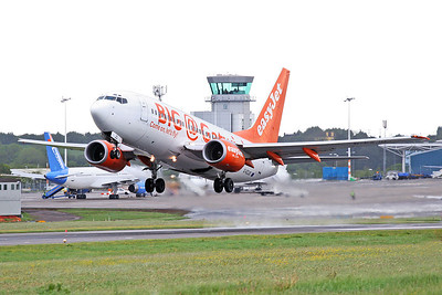 EasyJet B737-300 G-EZJD. Big @ Gatwick livery departing.