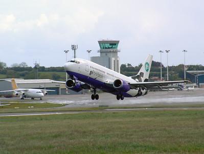 Go B737-300 G-IGOM lifting off from runway 27 Lulsgate. 25th May 2002.