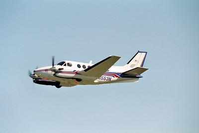 N1553N departs from runway 27, 1st July 2002.
