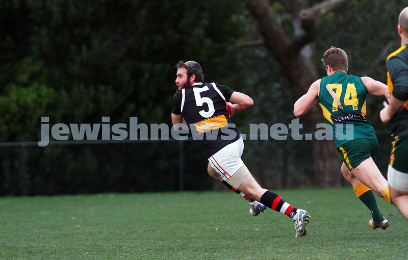 2-8-15. AJAX Black won a thriller against Old Trinity at Daley Oval.  With scores level late in the last quarter, a goal with seconds left on the clock secured Ajax the win 11.5 - 71 to Trinity 9.11 - 65 and a place in the finals.  Eli Adelist about to kick the winning goal. Photo: Peter Haskin