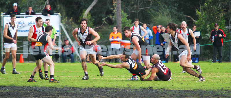 2-8-14. AJAX defeated Old Ivanhoe by 27 points at Gary Smorgon Oval. Ari Lewski gets a handball away under presure.  Photo: Peter Haskin