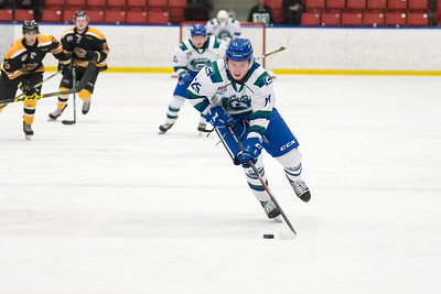Braydon Jenkins carries the puck during the home opener of the AJHL 2017 Regular Season between the Calgary Canucks and the Olds Grizzlies 9 17 at the Max Bell Centre.