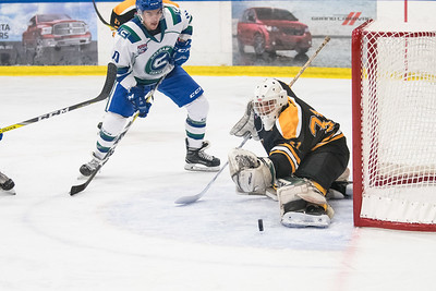 Olds rookie goalie Levi Mitchell turns away a shot from Noah Williams during the home opener of the AJHL 2017 Regular Season between the Calgary Canucks and the Olds Grizzlies 9 17 at the Max Bell Centre.