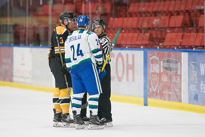 Hayden Ursulak and Austin Pickford discuss the penaltties during the home opener of the AJHL 2017 Regular Season between the Calgary Canucks and the Olds Grizzlies 9 17 at the Max Bell Centre.