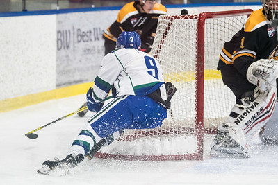 Cooper Page on the attack during the home opener of the AJHL 2017 Regular Season between the Calgary Canucks and the Olds Grizzlies 9 17 at the Max Bell Centre.