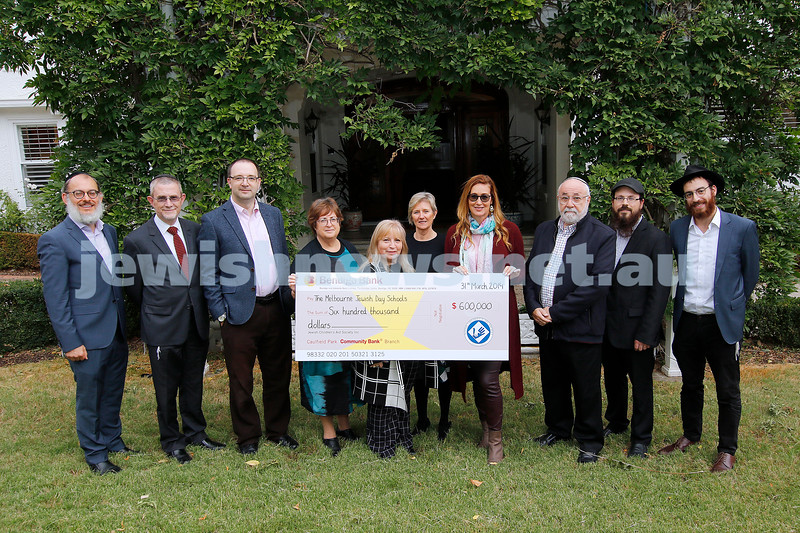 31-3-19. JCAS, the Jewish Children's Aid Society presents a cheque for $600,000 to the principals of the Jewish schools. Photo: Peter Haskin