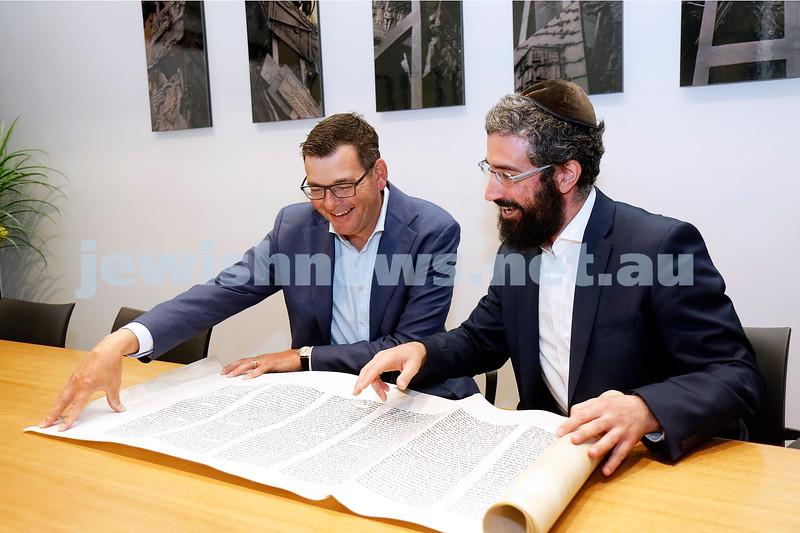 27-2-19. Victorian Premier Daniel Andrews being shown the Megillah for Purim by Rabbi Yaakov Glasman. Photo: Peter Haskin
