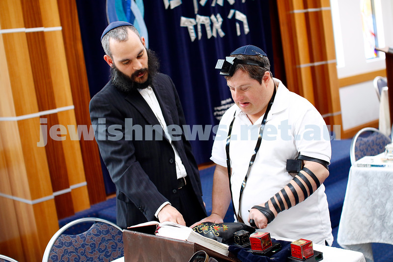 5-2-19. As part of the lead up to ShabbaTTogether, Zac Chester lays tephillin with Rabbi Reuvi Cooper at Malvern Chabad. Photo: Peter Haskin