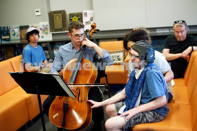 Late night Tuesday at the Lamm Library. <br /> Members of Access Inc came to listen to cellist Avraham Yee, and it was a very special moment for Baruch Rosenfeld. Despite being deaf, Baruch found a soul-stirring connection, as he sat with his hand on the cello and felt the music. Photo: Peter Haskin