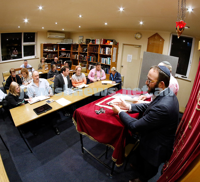 """Peach pre-season. It's almost that time of year, so South Caulfield Shul's Rabbi Daniel Rabin takes a """"training"""" session for some Haggadah revision and a refresher course on the many seder songs and tunes. Photo: Peter Haskin"""