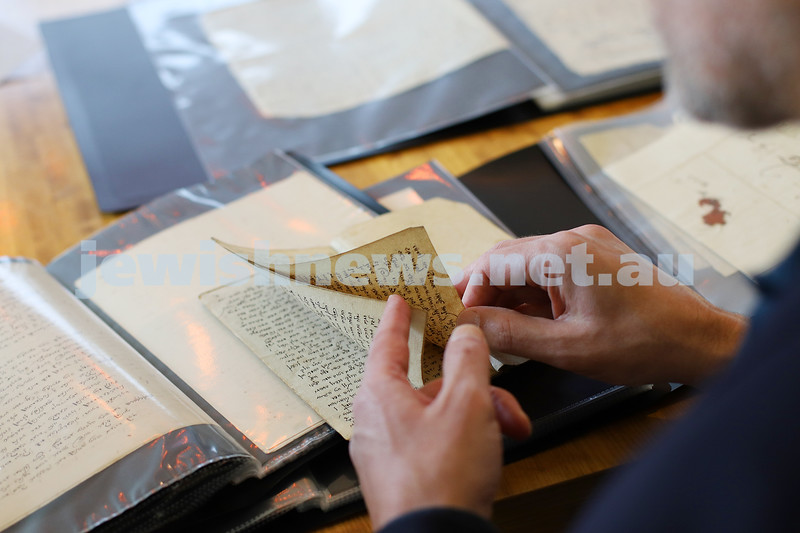 20-2-20. Robert Lehrer with just some of the 19th century Judaica and the writings of Rabbi Moshe Sofer that his family had in their possesion when they came to Australia in 1938. Photo: Peter Haskin