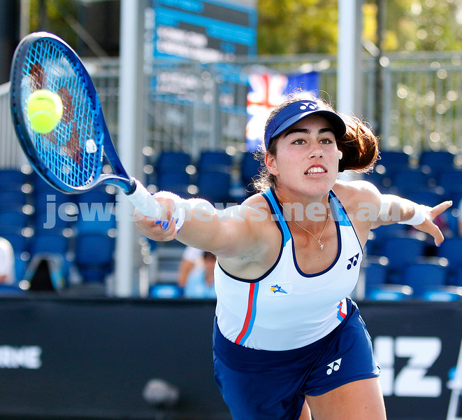 The moment the ball hits the raquet! Israeli Shavit Kimchi stretches for a volley during her girls junior doubles match at last weeks Australian Open. Photo: Peter Haskin