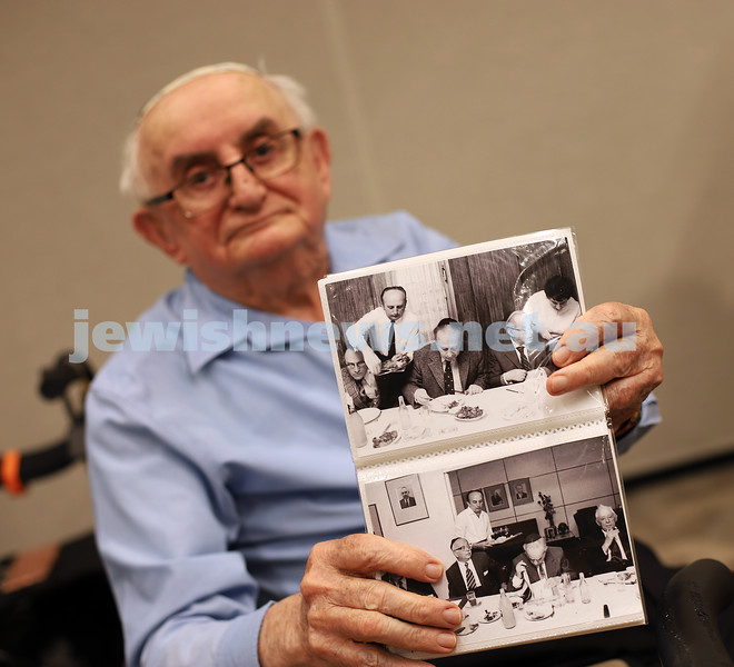 Great memories. Emmy Monash Aged Care resident 89 year old Josef Rewinson proudly showing off photos taken of him serving the late Yitzchak Rabin while he was living in Israel and working in the catering business. Photo: Peter Haskin