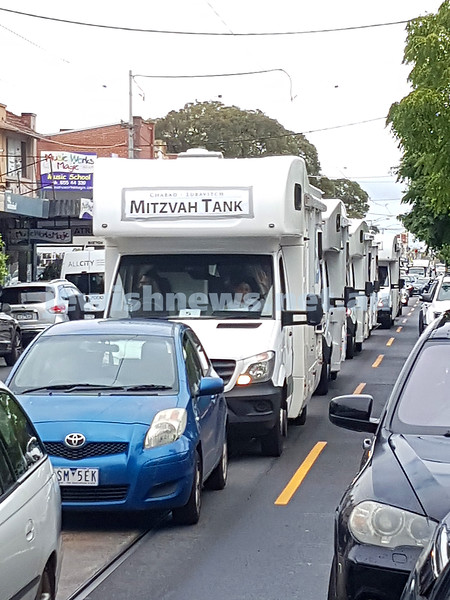 24-3-21. The Mitzvah Tank convoy heading down Glenhuntly Rd hand out shumrah matzah for Pesach. Photo: Peter Haskin