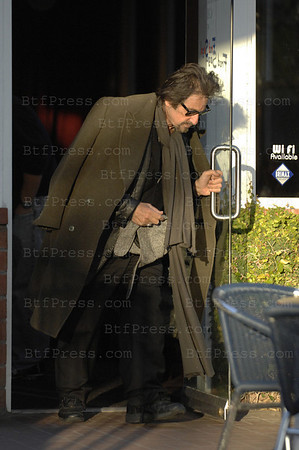 EXCLUSIVE. Santa monica, California, February 12,2009. Al Pacino have a special look today, kaki coat style army on his shoulders with at the origin three buttons, two survives, kaki pant, extra long kaki scarf, traditional black shoes with the left lace whose not fix, We know the expression Ò My tailor is rich Ò this time could be  Ò My tailor is poor Ò