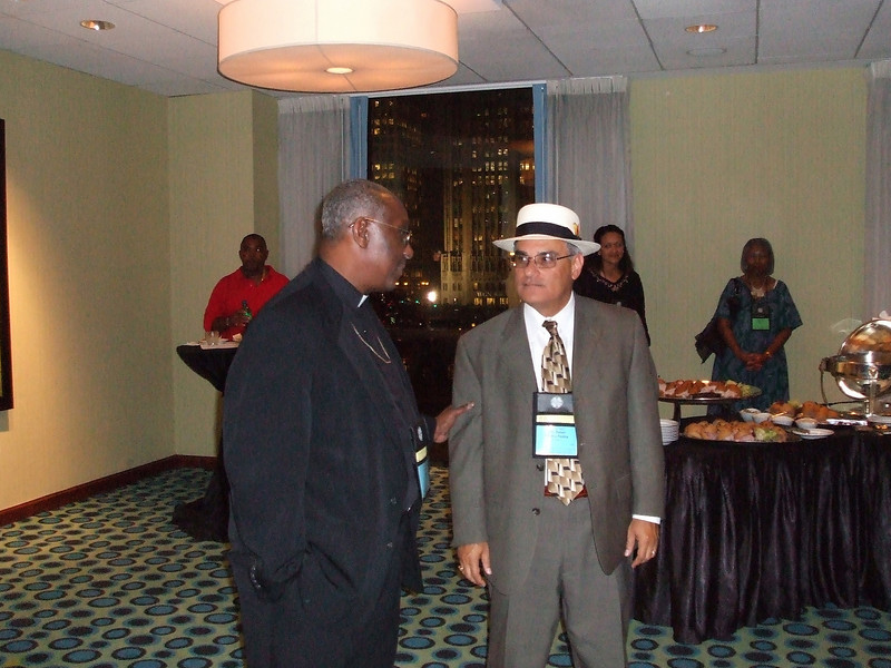 Pastors (L-R) Rafael Malpica Padilla, Executive Director for Global Missions and Rev. Shermon Hicks, Executive Director for the Multicultural Ministries in discussion during the Multicultural Ministries Reception at the ELCA Churchwide General Assembly on August 9, 2007. Location: Navy Pier, Chicago, Illinois.