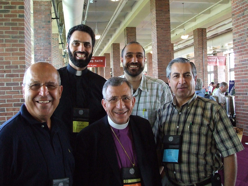 Pictured above (L to R bottom): Albert Asfour, Bishop Munib Younan (ELCJHL), Joseph Hussarq (ALAMEH); (L to R top): Rev. Rani Abdulmasih (Pastor of The Abundant Life Arabic Lutheran Church), Rev. Khader Elyateem (Pastor of Salam Arabic Lutheran Church);  at the ELCA Churchwide General Assembly. Location: Navy Pier, Chicago, Illinois