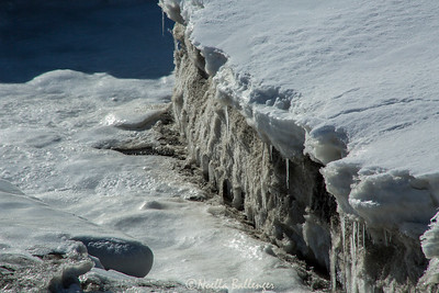 Along shoreline of Homer Spit, massive blocks of ice form and refreeze