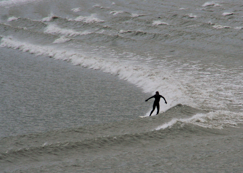 A surfer on the tidal bore at Turnigan Arm