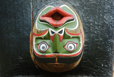 I have no idea what an upside down face represents on the totem