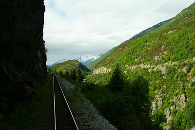A narrow ledge right of way is the path of the railroad to the top of the mountain.  The rails are three feet across and know as a narrow gage railroad allowing for sharper turns and narrow rights of way.