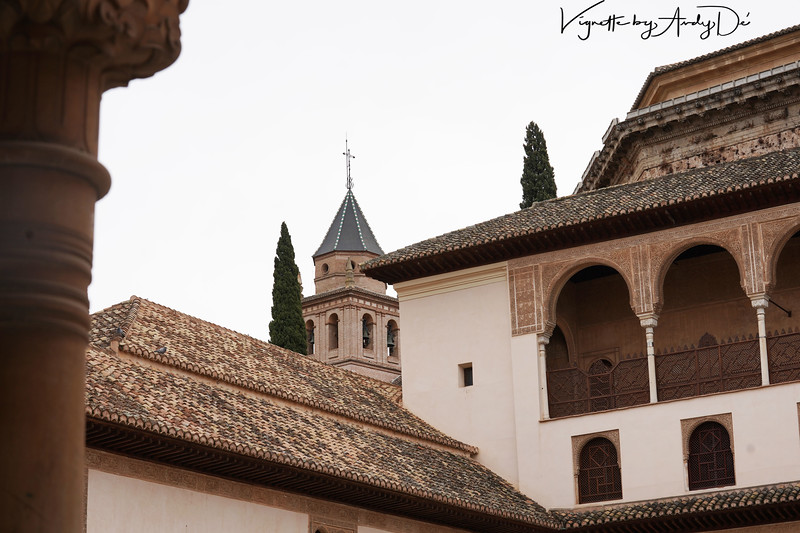Contrasting styles of architecture - the Moorish style from the Alhambra in sharp contrast to the Western Tudor style from the Tower of the Charles V Palace astride the Alhambra.