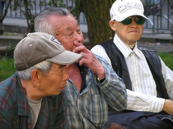 Three gentlemen in Chinatown