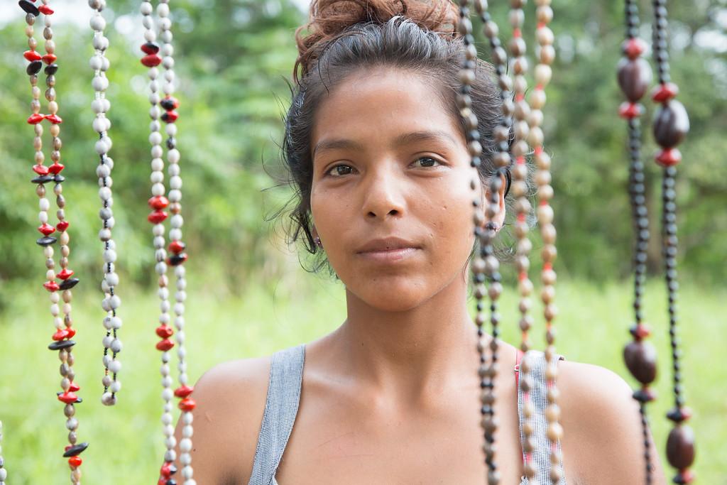 Girl selling beads