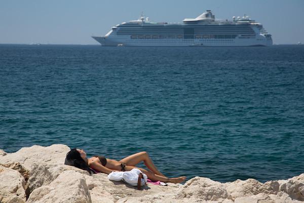 Sunbathing on the rocks in Cannes