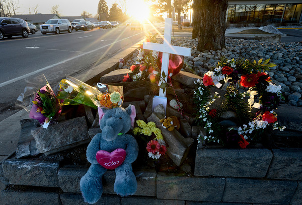 A growing temporary memorial is seen, Thursday, March 7, 2013, at the corner of 17th Ave. and Main Street in Longmont.<br /> (Matthew Jonas/Times-Call)