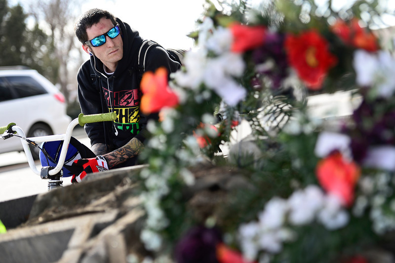 Levi Ledford, of Longmont, pauses to pay his respects for the victim at a temporary memorial, Thursday, March 7, 2013, at the corner of 17th Ave. and Main Street in Longmont.<br /> (Matthew Jonas/Times-Call)