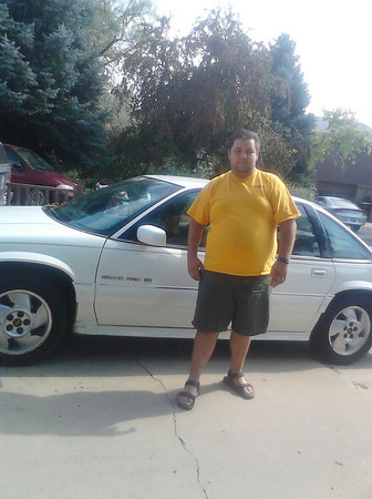 Dale Johnson, 21, is pictured in a photo from his Facebook profile with his white Pontiac Grand Prix in August. Johnson died Wednesday when a driver police believe was high on methamphetamine crashed an Altima into Johnson's car in the intersection of 17th Avenue and Main Street. (Facebook.com)