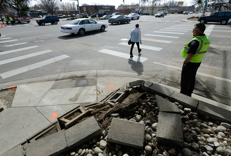 Master police officer Chris Martinchick stands at the intersection of 17th Avenue and Main Street during an investigation Thursday morning March 7, 2013 after Wednesday night's fatal accident. (Lewis Geyer/Times-Call)