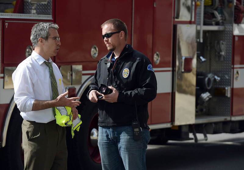 Deputy district attorney J.P. Martin, left, and master police officer Mike Stogsdill investigate the accident scene Thursday morning March 7, 2013 at 17th Avenue and Main Street.  (Lewis Geyer/Times-Call)