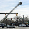 A Longmont Fire Department ladder truck is used during an investigation Thursday morning March 7, 2013 after Wednesday night's fatal accident at 17th Avenue and Main Street.  (Lewis Geyer/Times-Call)