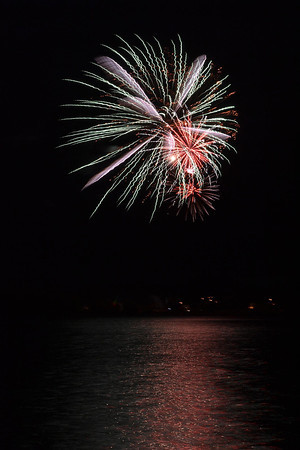 The City of Lafayette celebrates the 4th of July with a fireworks display over Waneka Lake. People began to surround Waneka Lake as early as 4 p.m. in anticipation of the pyrotechnic display. The fireworks exploded into colorful displays just after 9 p.m. and were received with cheers by the delighted crowd. (C. Alan Crandall/Colorado Hometown Weekly)
