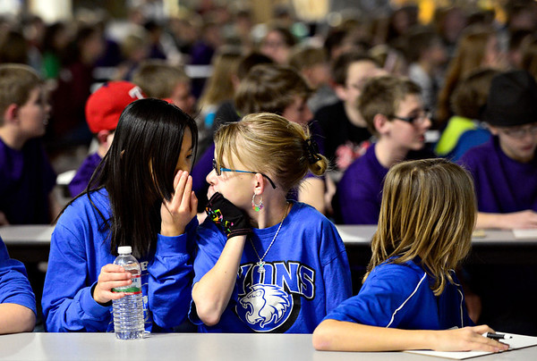 Lyons' Regina Fuster, left, and Alayna Brickman discuss a question during the 2013 St. Vrain Valley School District Middle School Geography Bee at Altona Middle School in Longmont on Wednesday, Jan. 30, 2013. <br /> (Greg Lindstrom/Times-Call)
