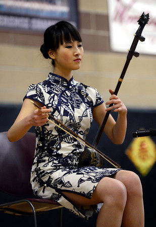 NianZhi Tang plays an erhu during the Longmont Chinese New Year Celebration Saturday Feb. 23, 2013 at Silver Creek High School. 2013 is the Year of the Water Snake, the snake is the sixth of twelve zodiac animal designations in the Chinese calendar. The event was sponsored by the Asian-Pacific Association of Longmont. NianZhi, 19, learned to play the erhu when she was eight years old. (Lewis Geyer/Times-Call)