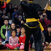Spectators sit on the floor to watch a kung fu demonstration during the Longmont Chinese New Year Celebration Saturday Feb. 23, 2013 at Silver Creek High School. 2013 is the Year of the Water Snake, the snake is the sixth of twelve zodiac animal designations in the Chinese calendar. The event was sponsored by the Asian-Pacific Association of Longmont. (Lewis Geyer/Times-Call)