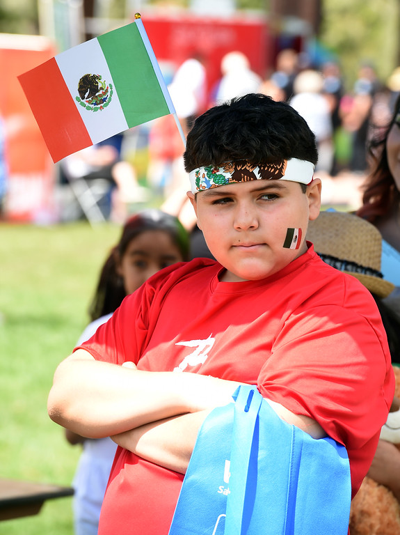. Aldo Martinez, 13, shows his pride in Mexico with the flags. Longmont held its annual Cinco de Mayo celebration at Roosevelt Park on Saturday. For more photos and a video, go to dailycamera.com. Cliff Grassmick  Photographer  May 5,  2018