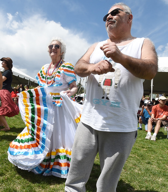 . Sister Mary Rosa dances with James Dominguez during the festival. Longmont held its annual Cinco de Mayo celebration at Roosevelt Park on Saturday. For more photos and a video, go to dailycamera.com. Cliff Grassmick  Photographer  May 5,  2018