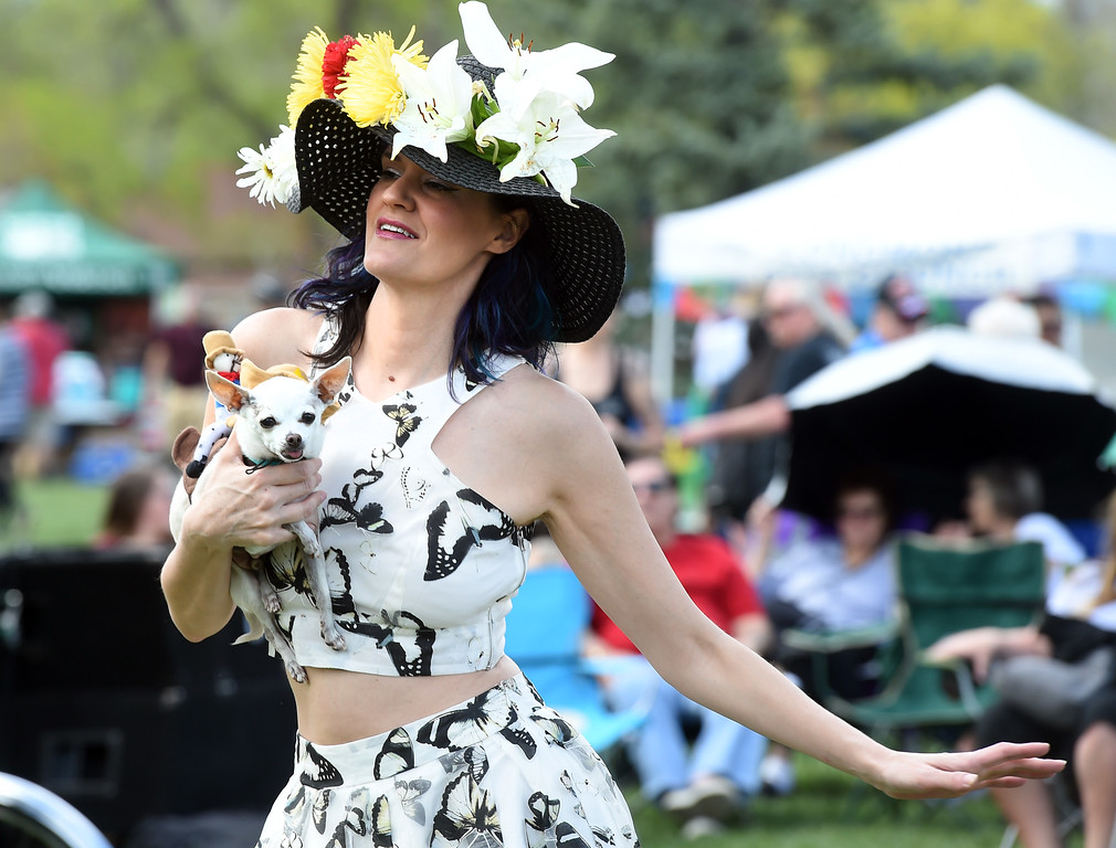 . Courtney Michelle dances with he chihuahua, Panchito, during the festival. Longmont held its  annual Cinco de Mayo celebration at Roosevelt Park on Saturday. For more photos and a video, go to dailycamera.com. Cliff Grassmick  Photographer  May 5,  2018